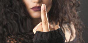 Beautiful rocker girl making middle finger gesture